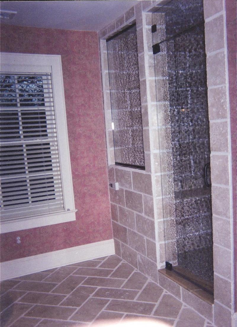 This is a rain glass style steam shower door with a moveable transom